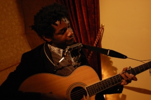 Singer L.A. Salami performing in our front room.Picture © Katie Smith