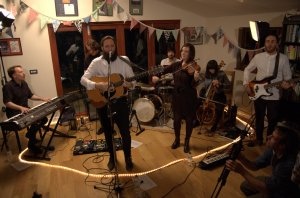 Band Revere perform an acoustic set in a Surrey front room