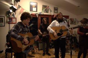 Sam Jackson plays guitar with Revere